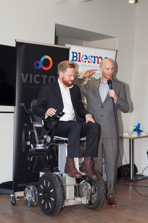 Samuel Rees (seated) and Marcus Crossley, from the Medical AMRC, outline the principles of the new mobility device, using a prototype device.