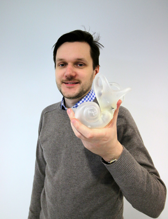 AMRC Project Engineer, Valdis Krumins with the first printed model.