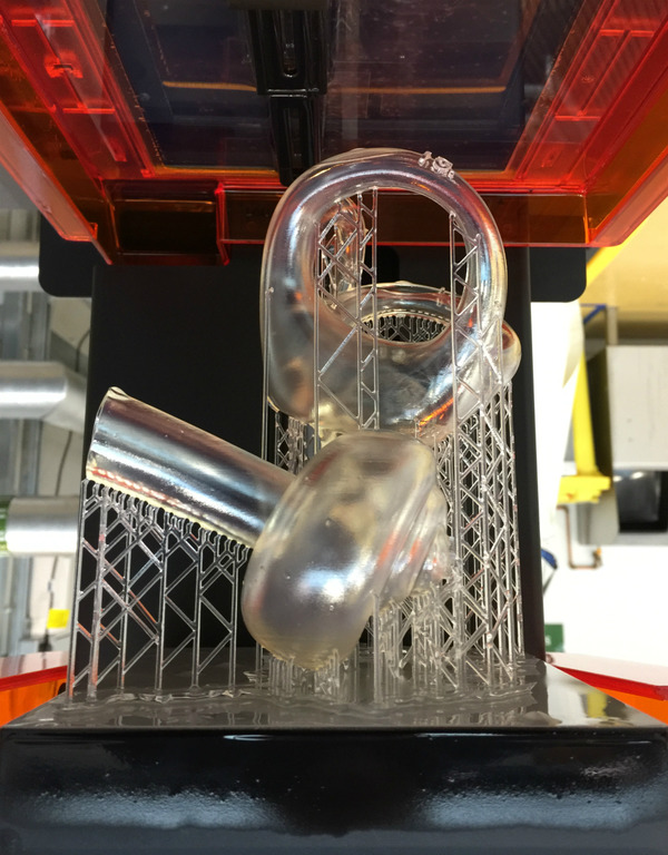 The model on the Form2 3D resin printer after printing had finished.