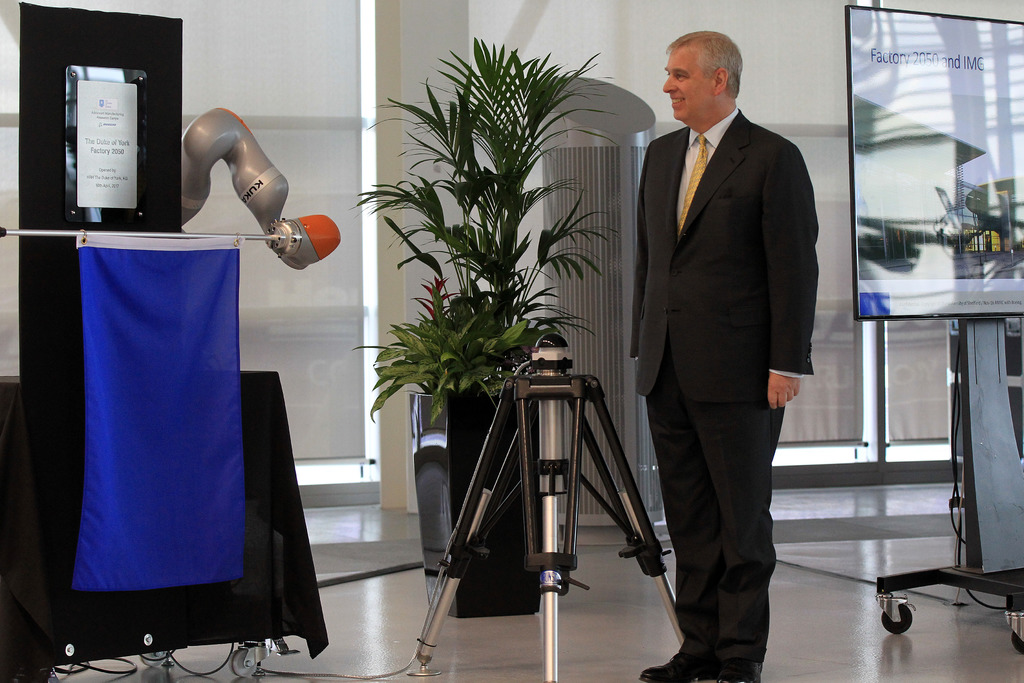 HRH The Duke of York unveils a plaque at the official opening of the AMRC Factory 2050 using a KUKA IIWA collaborative-robot or 'cobot'.