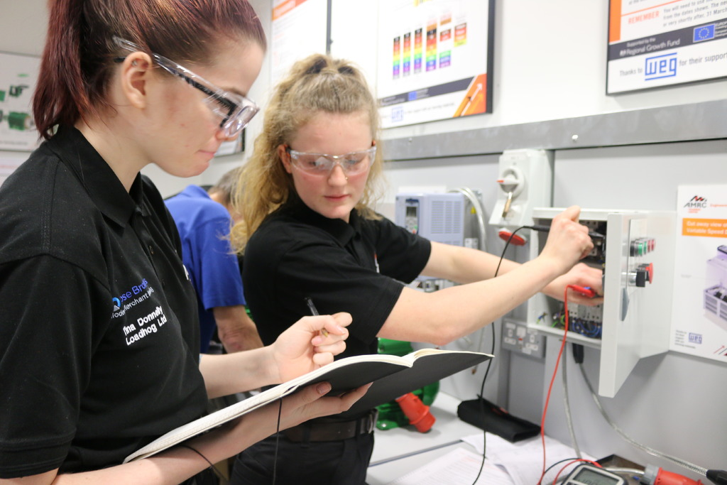 Bright sparks: Tina Donnelly, an apprentice with Loadhog Ltd, and Amy Brown, an apprentice with RE Field Services, pictured in the AMRC Training Centre electrical workshop.