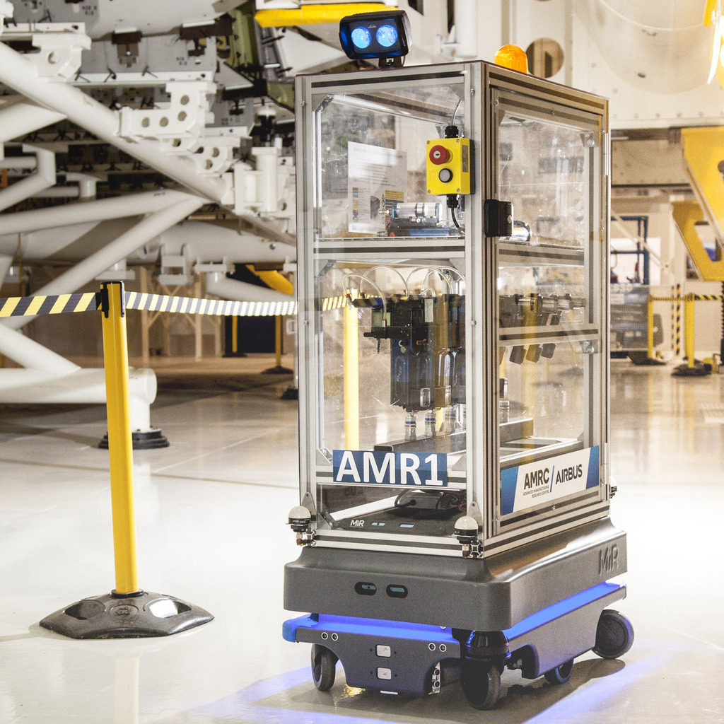The MiR200 robot with racking, integrated flashing beacon and direction indicator projector.