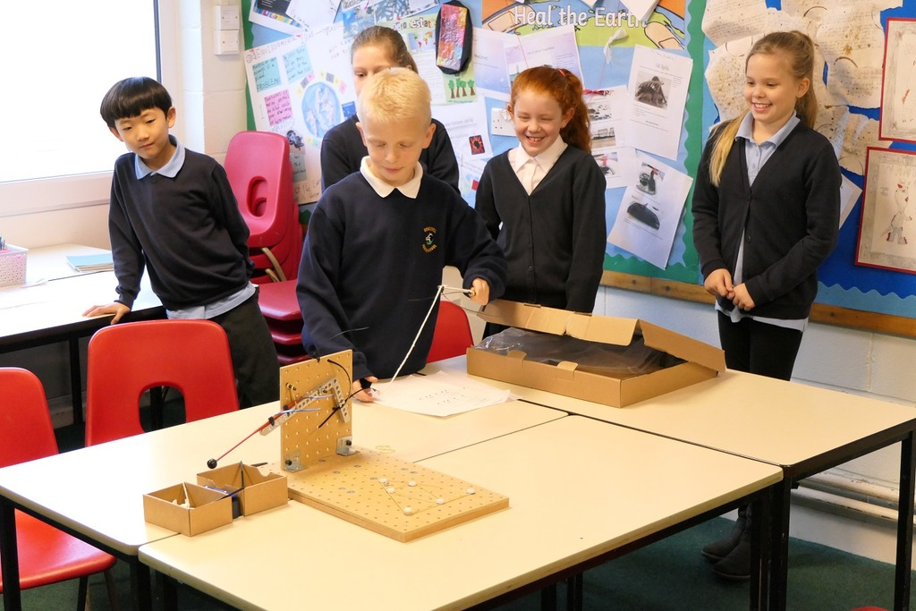 Members of Brockwell Junior School's STEM Club demonstrate their designs at work.
