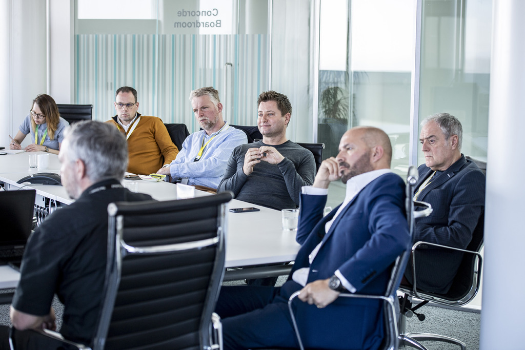 George Clarke, Mark Farmer and other members of MOBIE listeninging to AMRC CEO Colin Sirett talking about the centre's strong links with the University of Sheffield and industry.