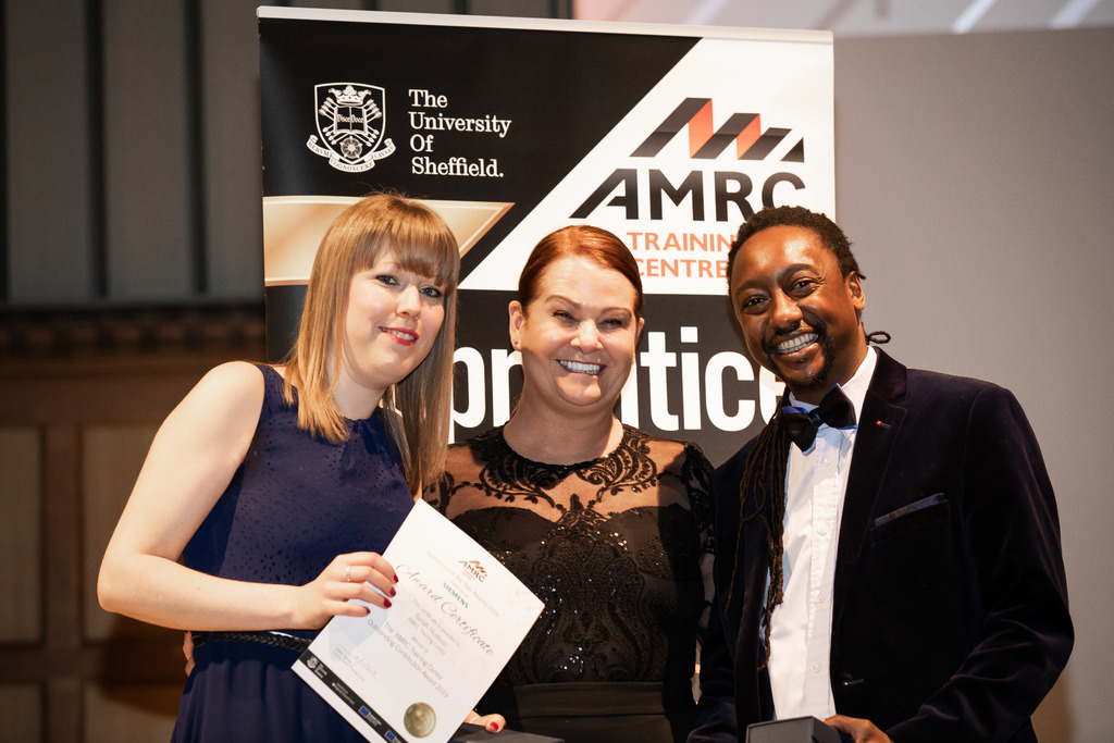 Top team: Lecturer Itai Vutabwarova and support staff Sarah Hudson collect their awards from training centre director Nikki Jones, centre.