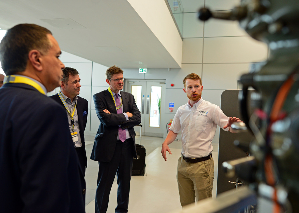 AMRC's Gavin Hill with Greg Clark, Juergen Maier and Hamid Mughal on their tour of Factory 2050.