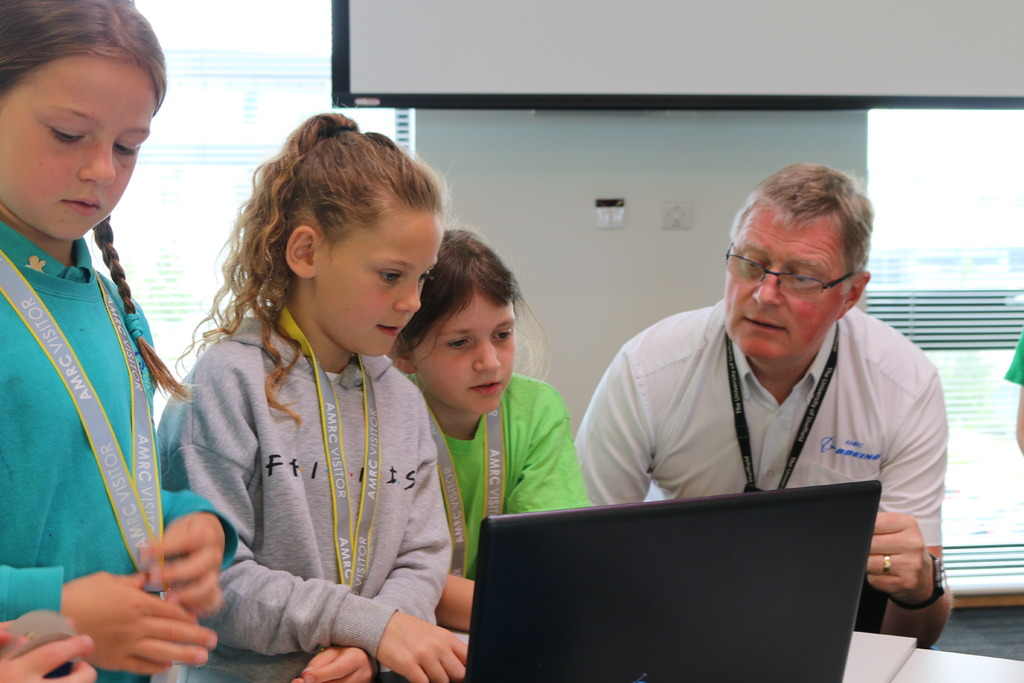 AMRC CEO Colin Sirett judging the primary school team racing cars.