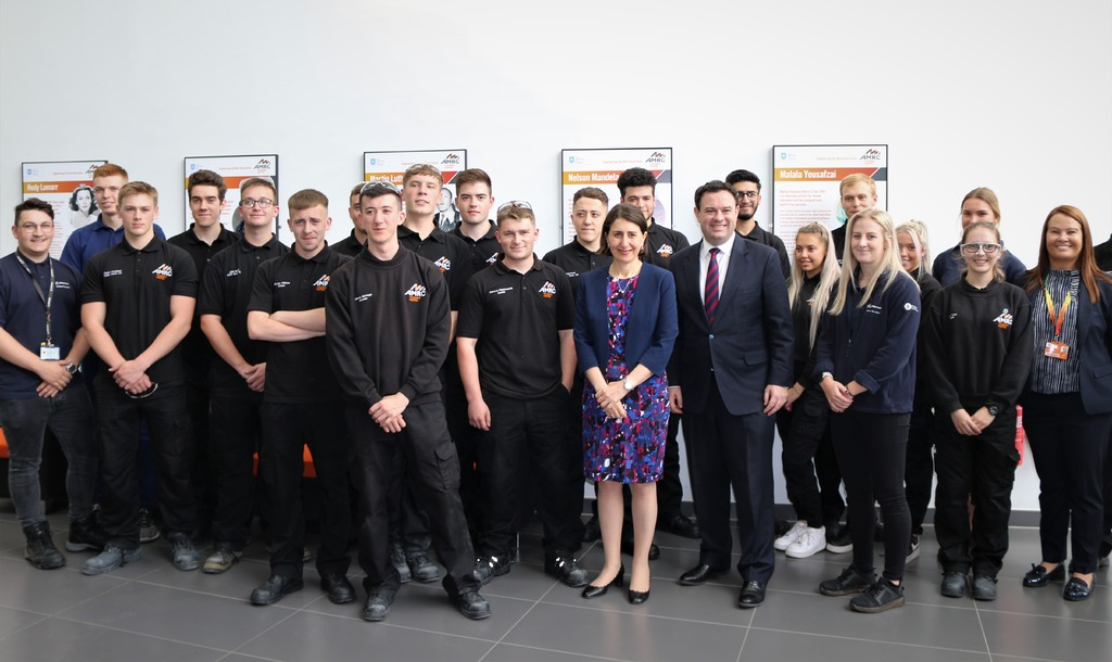 The Premier of New South Wales and Minister Ayres with current and former apprentices from the AMRC Training Centre.