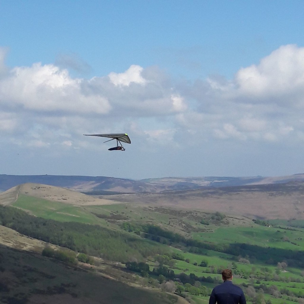 Director at Avian Hang Gliders, Dr Tim Swait, tests a hang glider in the Peak District.