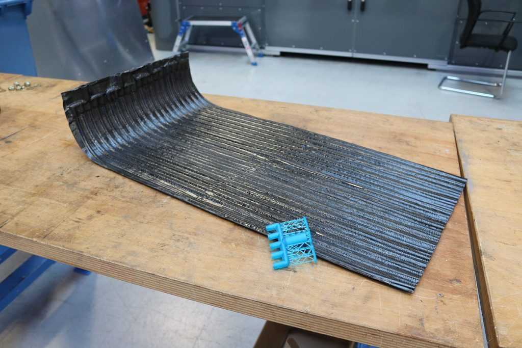 The AMRC took their demonstrator breeder blanket concept made from carbon fibre reinforced polymer (CFRP) to the UKAEA in Culham, where it was presented to Head of Technology, Dr Elizabeth Surrey.