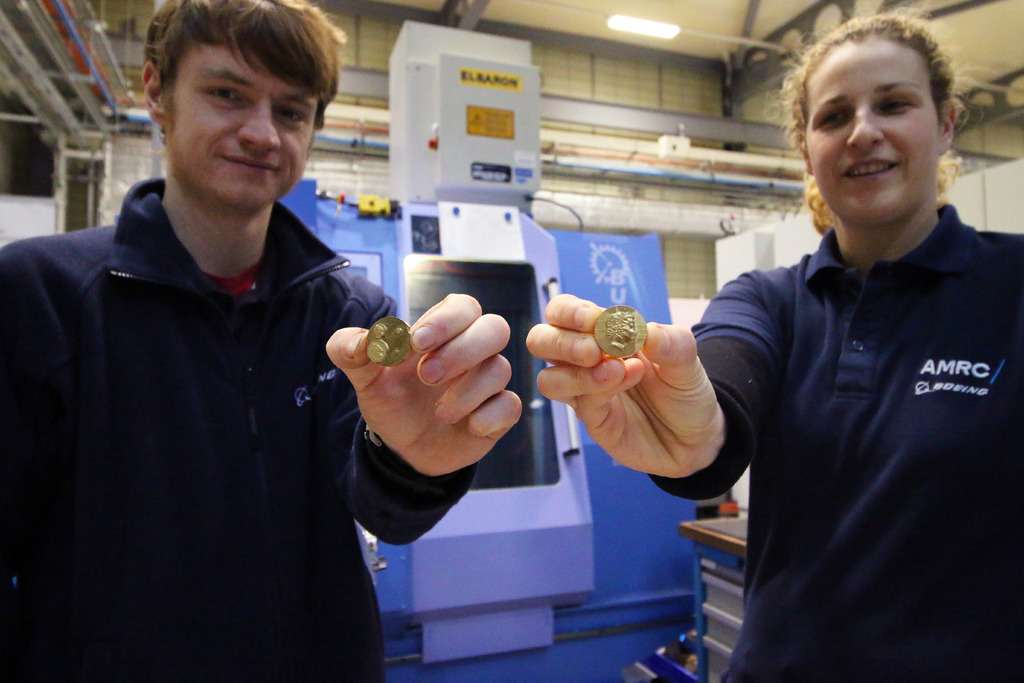 Engineers Joe Thickett and Emma Parkin in front of the seven-axis Starrag Bumotec S-191 mill-turn centre used to micro-machine the miniature portraits.