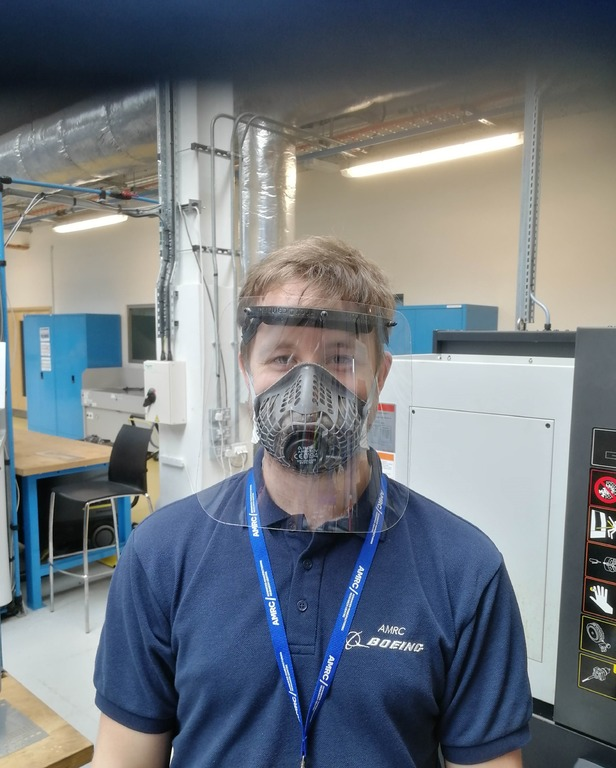 Daniel Tomlinson, Project Engineer at the AMRC Design and Prototyping Group, wearing one of the finished face visors.