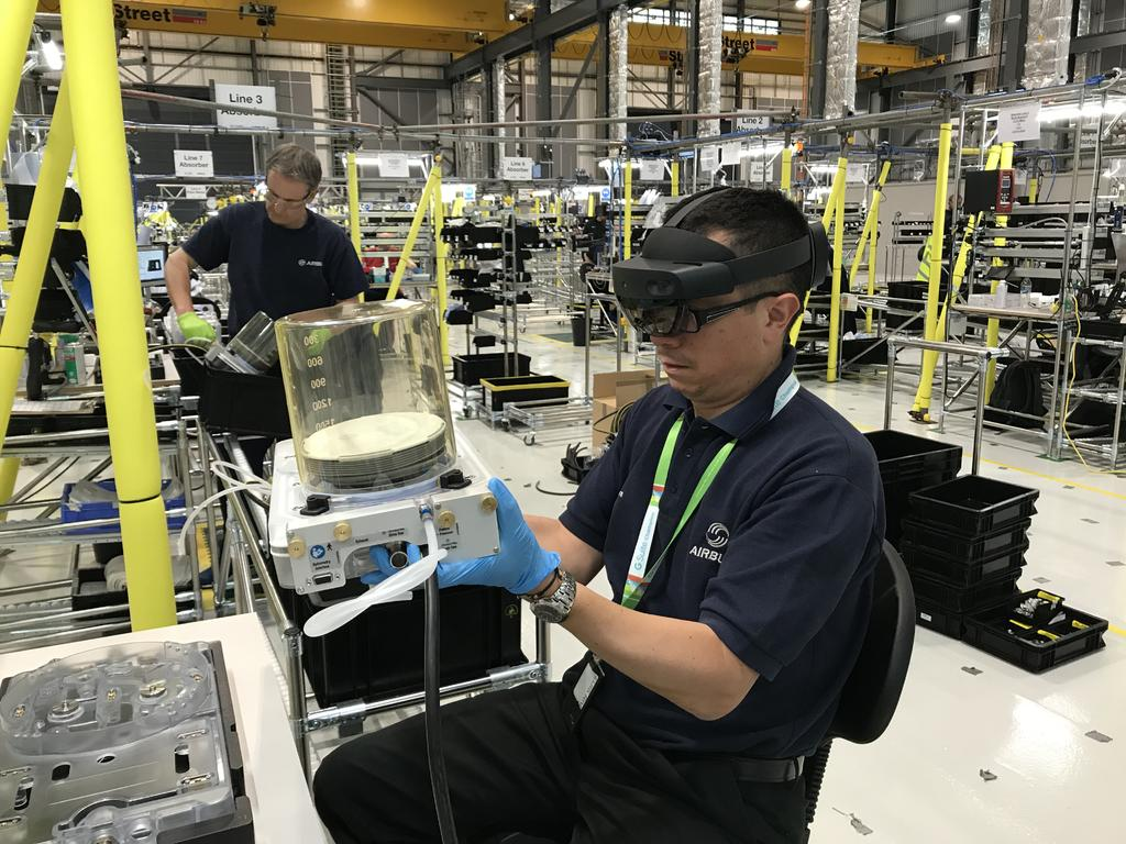 An Augmented Reality (AR) headset is used by a production line operative at AMRC Cymru to assemble life-saving ventilators.