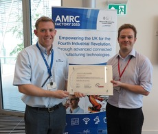 Austin Cook from BAE Systems, visits the AMRC Factory 2050, to present Ben Morgan with a commemorative plaque celebrating the BAE Systems Executive Committee Award.