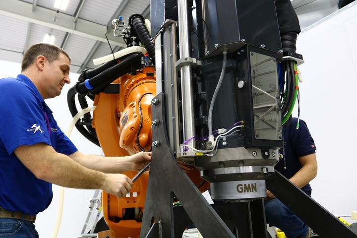 Team members from Electroimpact assisting with the installation of the newly upgraded KUKA Titan robot at the AMRC's Factory 2050.