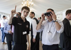 McLaren apprentice Ian Hutchinson demonstrates the Microsoft HoloLens at the event hel at the House of Commons.